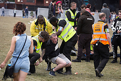 © Licensed to London News Pictures . 07/06/2015 . Manchester , UK . Security detain and remove two men at The Parklife 2015 music festival in Heaton Park , Manchester . Photo credit : Joel Goodman/LNP