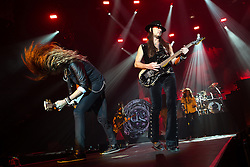 © Licensed to London News Pictures . 15/12/2015 . Manchester , UK . JOEL HOEKSTRA and REB BEACH . Whitesnake perform at the Manchester Arena . Photo credit : LNP