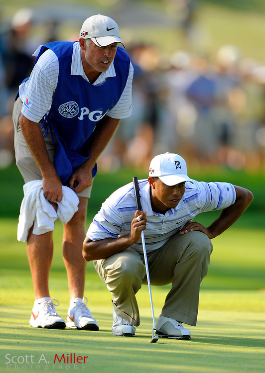 Aug 14, 2009; Chaska, MN, USA; Tiger Woods (USA) lines up a putt with his caddie Steve Williams during the second round of the 2009 PGA Championship at Hazeltine National Golf Club.  ©2009 Scott A. Miller