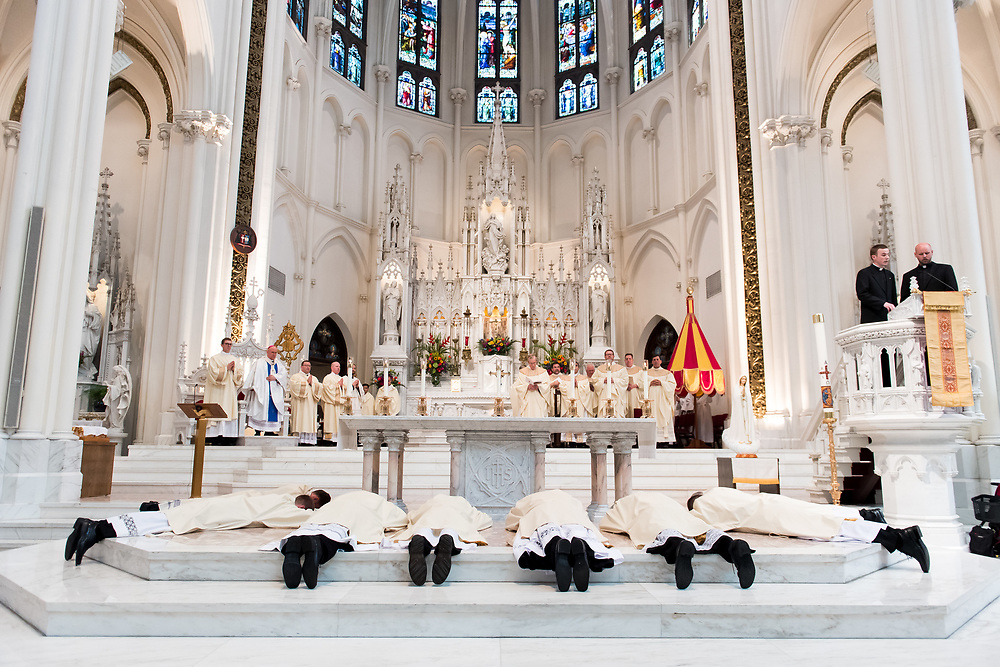 DENVER, CO - MAY 13: Ordinandi lay prostrate during a Mass of Holy Orders for their ordination to the priesthood at the Cathedral Basilica of the Immaculate Conception on May 13, 2017, in Denver, Colorado. (Photo by Daniel Petty/for Denver Catholic)