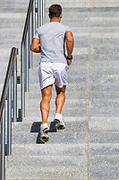 Young attractive man running in stairs