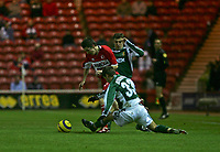 Photo: Andrew Unwin.<br /> Middlesbrough v Liteks Lovech. UEFA Cup. 15/12/2005.<br /> Middlesbrough's Adam Johnson (L) looks to go past Liteks Lovech's Demal Berberovic (R).