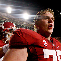 November 3, 2012; Baton Rouge, LA, USA; Alabama Crimson Tide offensive linesman Barrett Jones (75) celebrates following a win over the LSU Tigers in a game at Tiger Stadium. Alabama defeated LSU 21-17. Mandatory Credit: Derick E. Hingle-US PRESSWIRE