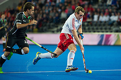 England's Chris Griffiths is watched by Benedikt Fuerk of Germany. England v Germany - Semi-Final Unibet EuroHockey Championships, Lee Valley Hockey & Tennis Centre, London, UK on 27 August 2015. Photo: Simon Parker