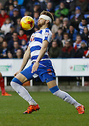 Reading defender, Chris Gunter takes the ball down calmly on his chest during the Sky Bet Championship match between Reading and Blackburn Rovers at the Madejski Stadium, Reading, England on 20 December 2015. Photo by Andy Walter.