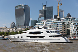 © Licensed to London News Pictures. 15/07/2018. London, UK.  Superyacht, Reef Chief, owned by the CEO of Crown Equipment Corporation, James Dicke visits London on the River Thames.  The 161ft custom built yacht sleeps up to 11 guests in 5 rooms, including a master suite, 3 double cabins, 1 twin cabin and 1 pullman bed,  plus carries up to 9 crew and boasts various luxuries including a Deck Jacuzzi. Reef Chief is one of an increasing number of superyachts to visit London this year. Photo credit: Vickie Flores/LNP