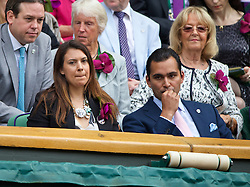 LONDON, ENGLAND - Saturday, July 5, 2014: 2013 Wimbledon Ladies' Champion Marion Bartoli with Joseph Katz in the royal box during the Ladies' Singles Final match on day twelve of the Wimbledon Lawn Tennis Championships at the All England Lawn Tennis and Croquet Club. (Pic by David Rawcliffe/Propaganda)
