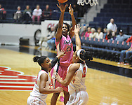 """Ole Miss' Courtney Marbra (25) vs. Georgia's Jasmine Hassell (12) and Shacobia Barbee (20) in women's basketball at the C.M. """"Tad"""" Smith Coliseum in Oxford, Miss. on Sunday, February 24, 2013. Georgia won 73-54."""