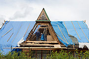 Workmen repair the timbers of a traditional Polish mountain house's gable roof, on 16th September 2019, in Zakopane, Malopolska, Poland.