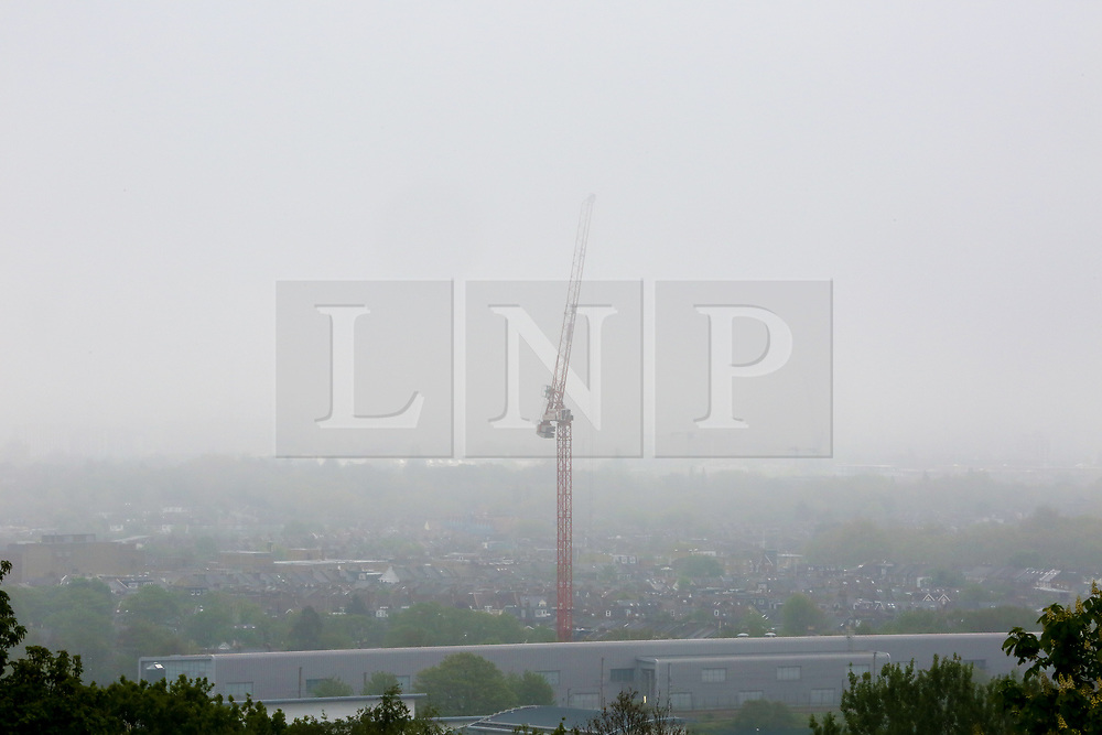 © Licensed to London News Pictures. 29/04/2019. London, UK. Low visibility of a building crane from Alexandra Palace as early morning mist coats north London. Photo credit: Dinendra Haria/LNP