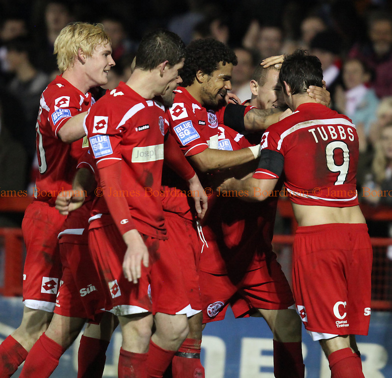 JAMES BOARDMAN / 07967642437.Matt Tubbs celebrates with his team mates after scoring Crawley's second goal during the Blue Square Premier match between Crawley Town and Mansfield Town at the Broadfield Stadium in Crawley March 30, 2011.
