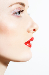 Close up Profile of Young Woman with Red Lips