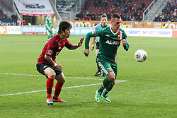 01.03.2014, SGL Arena, Augsburg, GER, 1. FBL, FC Augsburg vs Hannover 96, 23. Runde, im Bild l-r: im Zweikampf, Aktion, mit Hiroki Sakai #4 (Hannover 96), Arkadiusz Milik #9 (FC Augsburg) // during the German Bundesliga XXth round match between FC Augsburg and Hannover 96 at the SGL Arena in Augsburg, Germany on 2014/03/01. EXPA Pictures © 2014, PhotoCredit: EXPA/ Eibner-Pressefoto/ Kolbert<br /> <br /> *****ATTENTION - OUT of GER*****