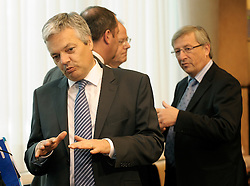 Didier Reynders, Belgium's finance minister, left and Jean-Claude Juncker, Luxembourg's prime minister, right, speak with colleagues during the Eurogroup meeting at EU headquarters in Brussels, Monday, July 6, 2009. (Photo © Jock Fistick)