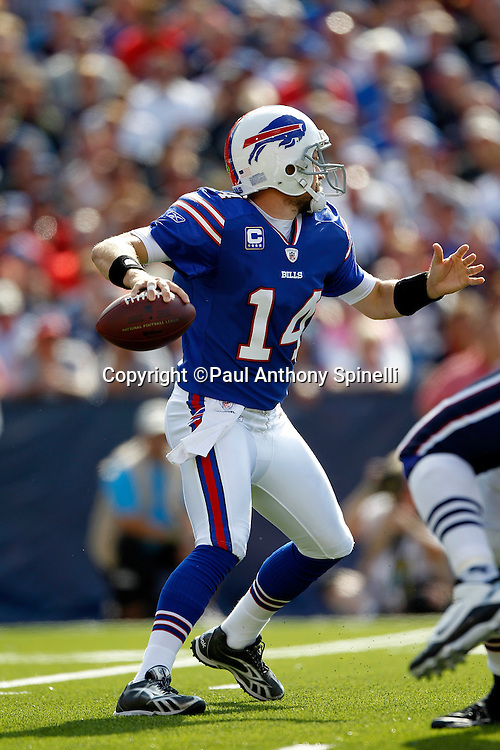 Buffalo Bills quarterback Ryan Fitzpatrick (14) throws a pass during the NFL week 3 football game against the New England Patriots on Sunday, September 25, 2011 in Orchard Park, New York. The Bills won the game 34-31. ©Paul Anthony Spinelli