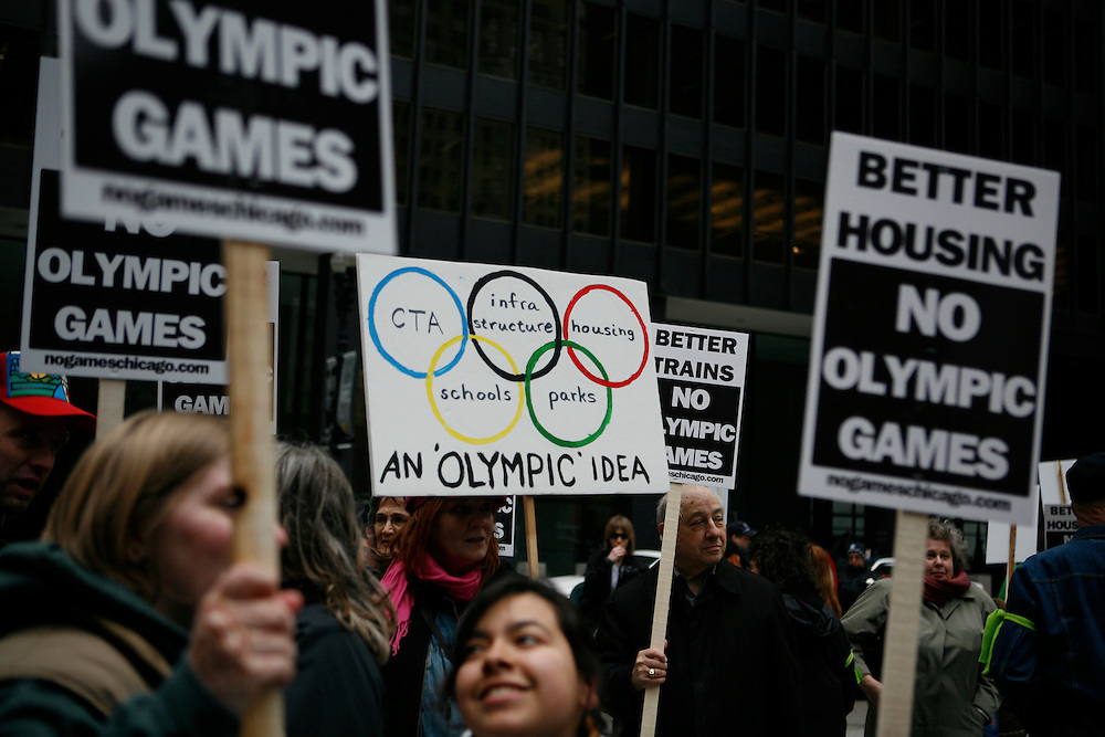 The United States' third largest city, Chicago, has become one of the world's final four candidates to host the 2016 summer olympics. On 2 April 2009, when the International Olympics Committee paid a visit to Chicago, a newly formed group called No Games Chicago, staged a demonstration in the city's downtown. The group is demanding that Chicago Mayor Richard Daley better the situation for Chicago's residents before inviting the costly olympics to the city. ///Protestors holds a sign against the 2016 olympics in Chicago at Federal Plaza in downtown Chicago.