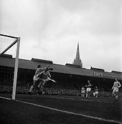 26/04/1964<br /> 04/26/1964<br /> 26 April 1964<br /> F.A.I. Cup Final: Shamrock Rovers v Cork Celtic at Dalymount Park, Dublin. The game ended 1-1 and went to a replay that Rovers won. Cork goalie Blount clashes with Jackie Mooney of Rovers.