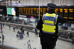 © Licensed to London News Pictures. 07/09/2020. London, UK. A British Transport police officer looks down at the concourse at Waterloo Station. Train capacity is supposed to reach 90% today as holidays come to an end and schools return. Photo credit: Peter Macdiarmid/LNP