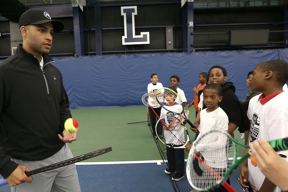 May 15, 2014, New Haven, Connecticut:<br /> Former professional tennis player James Blake leads a drill during a free tennis lesson and clinic Thursday, May 15, 2014 in advance of the 2014 New Haven Open at the Yale University Tennis Center in New Haven, Connecticut. <br /> (Photo by Billie Weiss/New Haven Open)