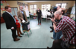 Sinn Fein's Party leader Gerry Adams, Joined with Matt Carthy and his son Sean, perpares his vote for local and European Elections at Doolargy National School in Ravensdale, County Louth, Ireland,  Friday May 23rd. Polling stations will remain open until 10pm. Almost 2,000 candidates are contesting the 949 local authority seats, while 41 hopefuls are in the race for 11 MEP seats spread over three constituencies while counting has begun in the local elections in Northern Ireland. Over 900 candidates are competing for the 462 seats on 11 new local authorities. Final results are expected to be known by tomorrow afternoon. Counting in the European Elections begins in Belfast on Monday morning.Friday, 23rd May 2014. Picture by  i-Images / i-Images