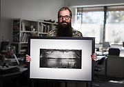 Stefan Roberts with a print from one of his home made pinhole cameras