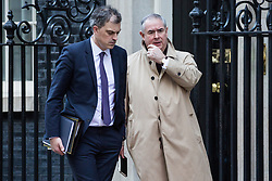 London, UK. 8th January, 2019. Julian Smith MP, Chief Whip, and Geoffrey Cox QC MP, Attorney General, leave 10 Downing Street following the first Cabinet meeting since the Christmas recess.