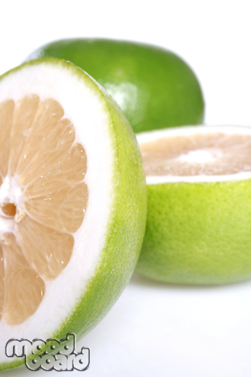 Closeup of halved grapefruits on white background
