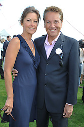 BRIAN CONLEY and his wife ANNE-MARIE at the 27th annual Cartier International Polo Day featuring the 100th Coronation Cup between England and Brazil held at Guards Polo Club, Windsor Great Park, Berkshire on 24th July 2011.
