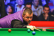 Mark Allen eyes a shot during the Snooker Players Championship Final at EventCity, Manchester, United Kingdom on 27 March 2016. Photo by Pete Burns.