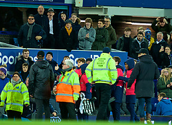 LIVERPOOL, ENGLAND - Sunday, March 3, 2019: Everton supporters react as a ball-boy claps towards manager Jürgen Klopp as Derek Hatton and Peter Reid (top) look on after the FA Premier League match between Everton FC and Liverpool FC, the 233rd Merseyside Derby, at Goodison Park. The game ended 0-0. (Pic by Paul Greenwood/Propaganda)