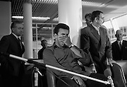 Muhammad Ali In Dublin..1972..11.07.1972..07.11.1972..11th July 1972..Prior to his fight against Al 'Blue' Lewis at Croke Park ,Dublin, former World Heavyweight Champion,Muhammad Ali arrives at Dublin Airport..The fight was part of his build up for for a championship fight against the current World Champion, 'Smokin'  Joe Frazier. Ali had been stripped of the title partly due to his refusal to join the American military during The Vietnam War,which he had opposed...The stress of a press conference. Muhammad Ali is pictured stifling a yawn before his press conference and after his long flight from the USA.
