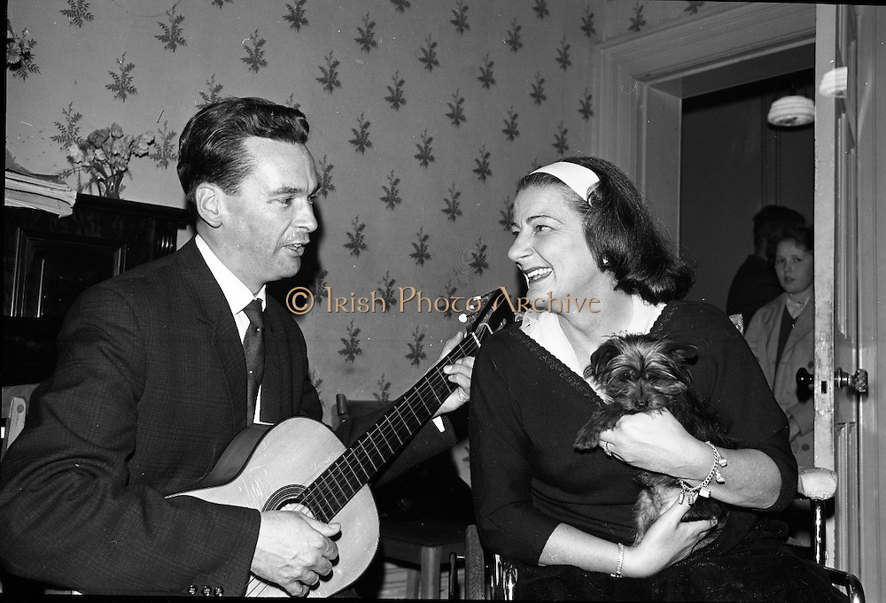 At the Cheshire Home, Shillelagh, Co. Wicklow, a variety concert featuring leading performers from Dublin was held for the entertainment of patients.Guitarist and Ballad Singer, John Hughes, sings a request for Joan Horan and her pet dog Nikki.  Mrs. Horan won two gold medals at the Special Olympics in Rome in 1960..10.10.1963