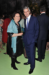 SUZY MENKES and SIR STUART ROSE at a dinner hosted by Cartier in celebration of the Chelsea Flower Show held at Battersea Power Station, 188 Kirtling Street, London SW8 on 23rd May 2011.