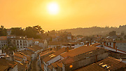 Vivid and bright orange sunset over the city of Santiago de Compostela, Galicia, Spain.