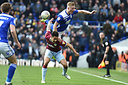 Birmingham City defender Michael Morrison (28) leaps on the back of Aston Villa forward Andre Green (19) during the EFL Sky Bet Championship match between Birmingham City and Aston Villa at St Andrews, Birmingham, England on 10 March 2019.