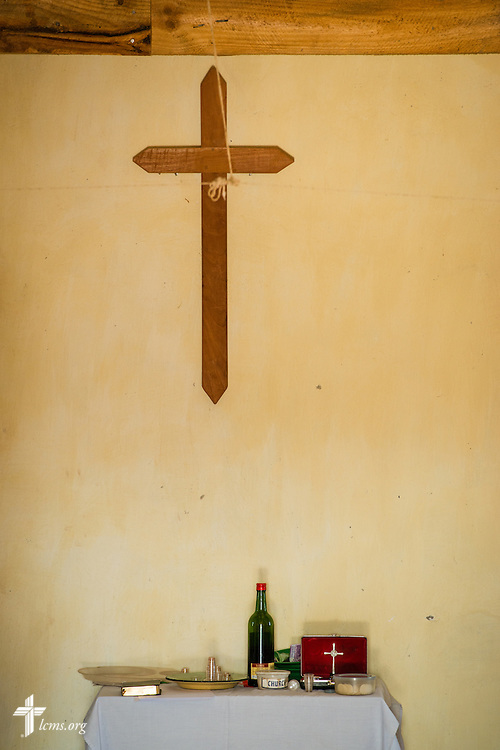 The elements lay on the altar under the wooden cross at a Confessional Lutheran Church–Malawi Synod parish on Saturday, Sept. 26, in Embangweni, Malawi. LCMS Communications/Erik M. Lunsford