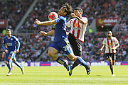 Sunderland defender, on loan from Tottenham Hotspur, DeAndre Yedlin (24)  stops Leicester City forward Shinji Okazaki (20)  during the Barclays Premier League match between Sunderland and Leicester City at the Stadium Of Light, Sunderland, England on 10 April 2016. Photo by Simon Davies.