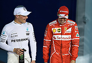 Valtteri Bottas of Mercedes AMG Petronas, with Sebastian Vettel of Scuderia Ferrari, after winning his maiden pole position during the Bahrain Formula One Grand Prix Qualifying session at the International Circuit, Sakhir<br /> Picture by EXPA Pictures/Focus Images Ltd 07814482222<br /> 15/04/2017<br /> *** UK &amp; IRELAND ONLY ***<br /> <br /> EXPA-EIB-170415-0332.jpg