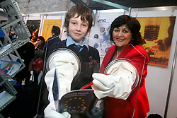 "NO REPRO FEE: Dublin Thursday 12th January 2012: Shirts which never wrinkle, paper from apples and rear windows with programmable lights - the EU stand at the BT Young Scientist gave visitors a chance to check out the latest EU-funded research and to chat with EU research staff about careers and the work they do. Pictured (l-r) at the European Commission stand was Oisin Martyn from St Patricks Classical School, Navan with Barbara Nolan, Director of the European Commission Representation in Ireland, Dundalk demonstrating the ""glove box"" which helps users to learn about the EU Joint Research Centre's work on nuclear research. Glove boxes are normally used in nuclear facilities and laboratories for the handling and storage of radioactive material. Picture Conor McCabe Photography.