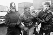 Police arrest a miners picket at Hatfield Main Colliery during the 1984 1985 miners strike. January 1985...&copy; Martin Jenkinson<br />