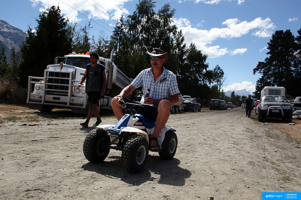 A man uses a small quad bike during the 50th Anniversary Glenorchy Race meeting. The races, which originally started in the 1920's, were resurrected in 1962 and have been run by local farmers and the rugby club on the first Saturday after New Years Day ever since. Glenorchy, Otago, New Zealand. 7th January 2012