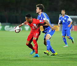 Nathaniel Clyne of England (Liverpool) battles for the ball with Nicola Chiaruzzi of San Marino (SP Tre Penne)  - Mandatory byline: Joe Meredith/JMP - 07966386802 - 05/09/2015 - FOOTBALL- INTERNATIONAL - San Marino Stadium - Serravalle - San Marino v England - UEFA EURO Qualifers Group Stage
