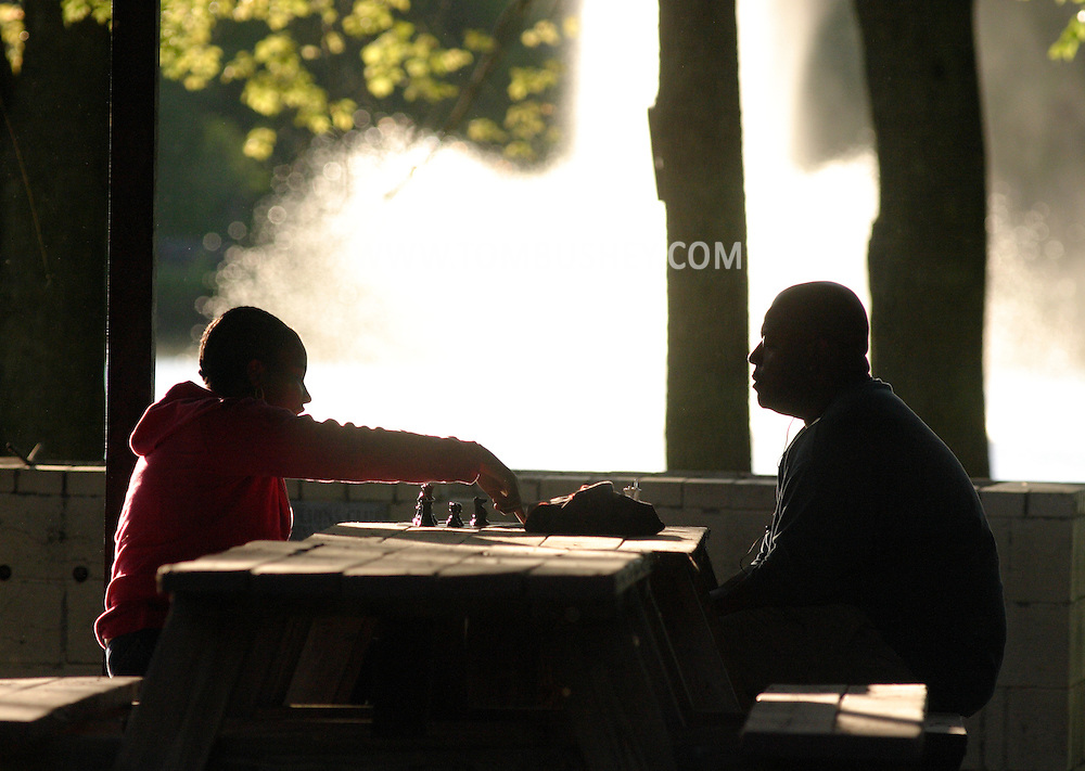 Middletown, N.Y. - A man and a teenager play chess at a picnic table in a pavillion at Fancher-Davidge Park on May 20, 2006. ©Tom Bushey