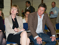 © Licensed to London News Pictures. 17/05/2012. London, UK. Labour MP Harriet Harman (left) and Actor Hugh Grant (right) attend a rally for media reform organised by Hacked Off and the Co-ordinating Centre for Media Reform at Central Hall, Westminster, London on May 17, 2012. Photo credit : Ben Cawthra/LNP