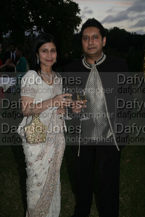 Raj and Sandy Kumar, QUINTESSENTIALLY AND ELEPHANT FAMILY TRUNK SHOW PARTY. SERPENTINE PAVILION, HYDE PARK. 16 SEPTEMBER 2007. -DO NOT ARCHIVE-© Copyright Photograph by Dafydd Jones. 248 Clapham Rd. London SW9 0PZ. Tel 0207 820 0771. www.dafjones.com.