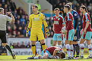 Tom Heaton (Burnley) talks to Jonathan Moss (Referee) as Joey Barton (Burnley) lays on the ground having been tackled by Sebastian Polter (QPR) during the Sky Bet Championship match between Burnley and Queens Park Rangers at Turf Moor, Burnley, England on 2 May 2016. Photo by Mark P Doherty.