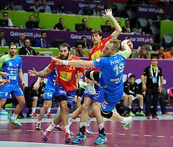 Miha Zvizej #19 of Slovenia during handball match between National Teams of Slovenia and Spain at Day 9 of 24th Men's Handball World Championship Qatar 2015 on January 23, 2015 in Duhail Handball Sports Hall, Doha, Qatar. Photo by Slavko Kolar / Sportida