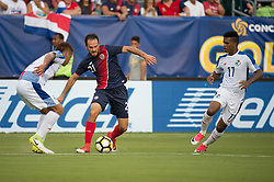 """July 19, 2017 - Philadelphia, Pennsylvania, U.S - Costa Rica forward MARCO URE""""A (21) dribbles by Costa Rica midfielder YELTSIN TEJEDA (17) during CONCACAF Gold Cup 2017 action at Lincoln Financial Field in Philadelphia, PA.  Costa Rica defeats Panama 1 to 0. (Credit Image: © Mark Smith via ZUMA Wire)"""