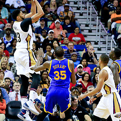 Oct 28, 2016; New Orleans, LA, USA;  New Orleans Pelicans forward Anthony Davis (23) shoots over Golden State Warriors forward Kevin Durant (35) during the second quarter of a game at the Smoothie King Center. Mandatory Credit: Derick E. Hingle-USA TODAY Sports