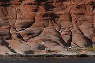Hikers explore red sandstone cliffs of Puerto Gato, Baja, Mexico.